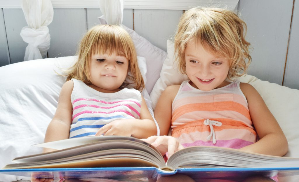 Girls read a book before bed
